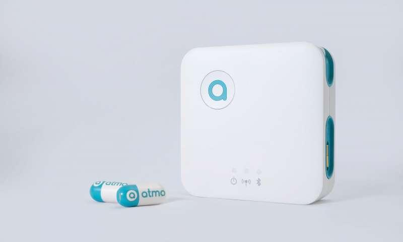 The pill sends data to a handheld external receiver which transfers information to a mobile app via Bluetooth