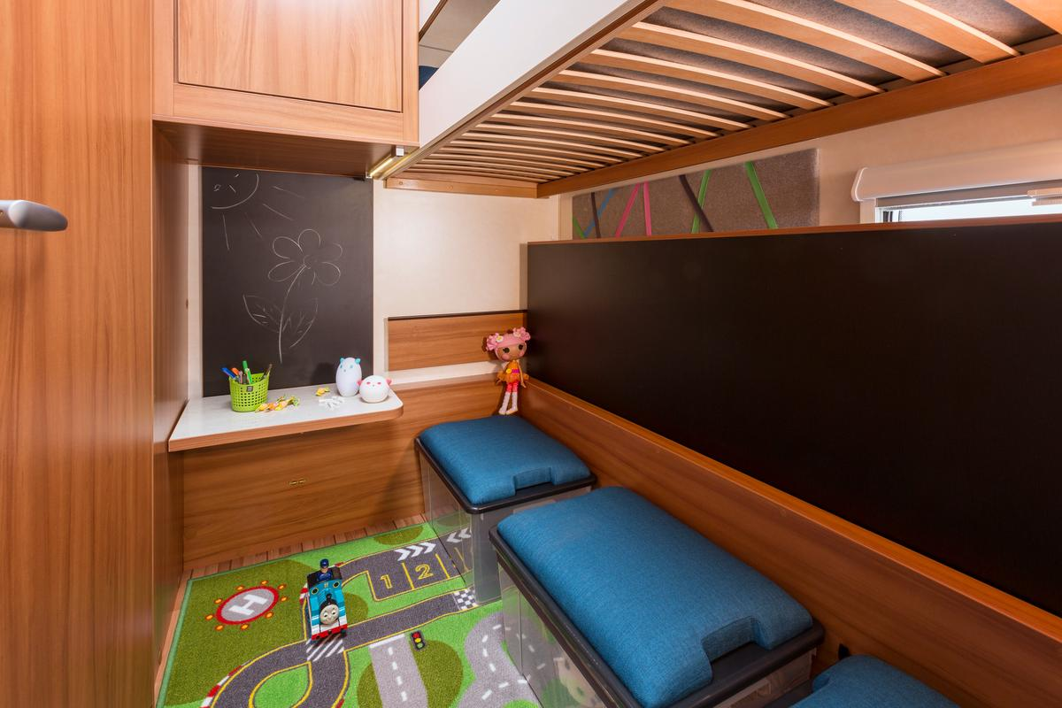 The CaraKids CaraOne caravan includes a kids' bunk bedroom that converts into a more spacious play area
