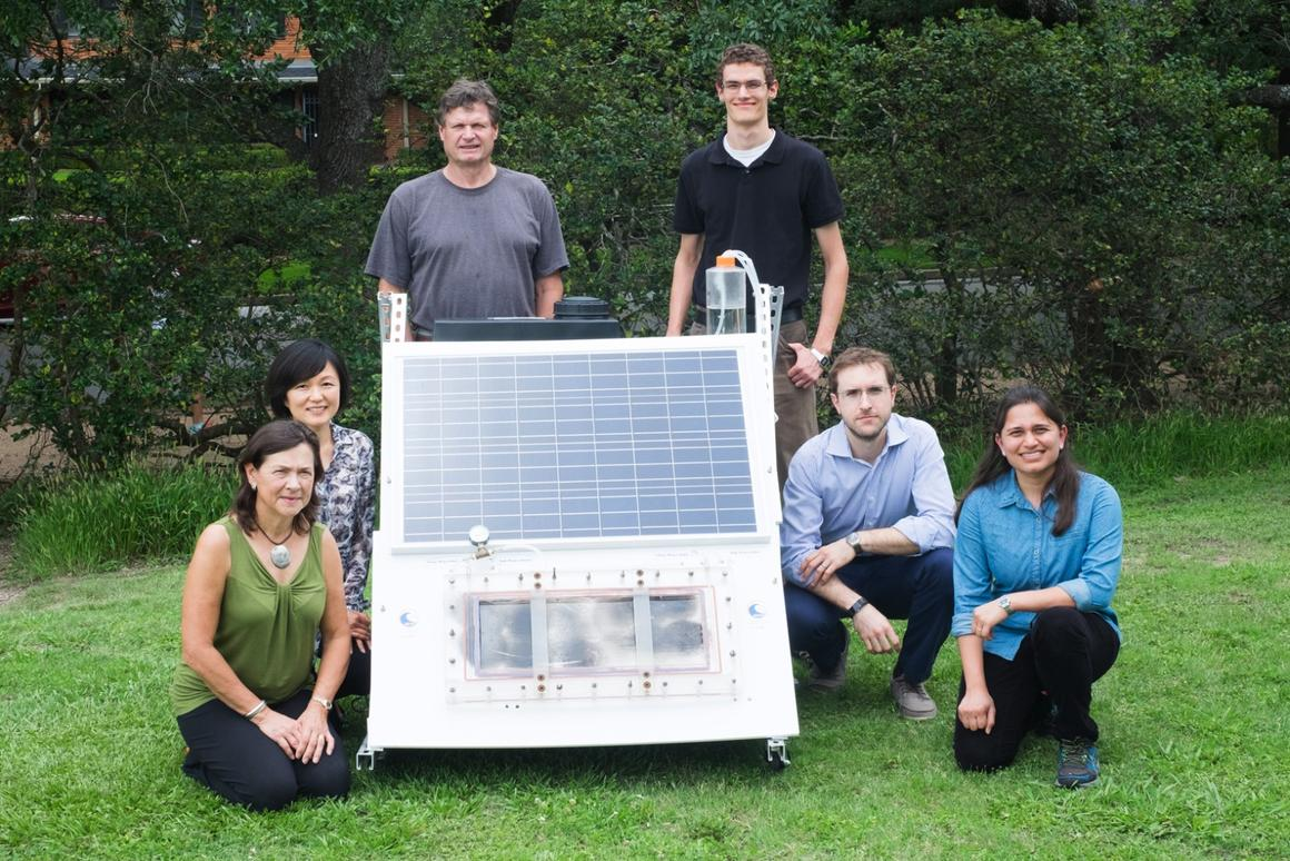 The researchers with a scaled-up version of their solar membrane distillation system