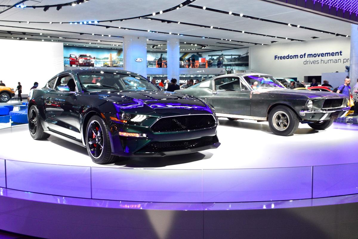 The 1968 Ford Mustang GT 390 from the movieBullittnext to Ford's new Mustang Bullitt