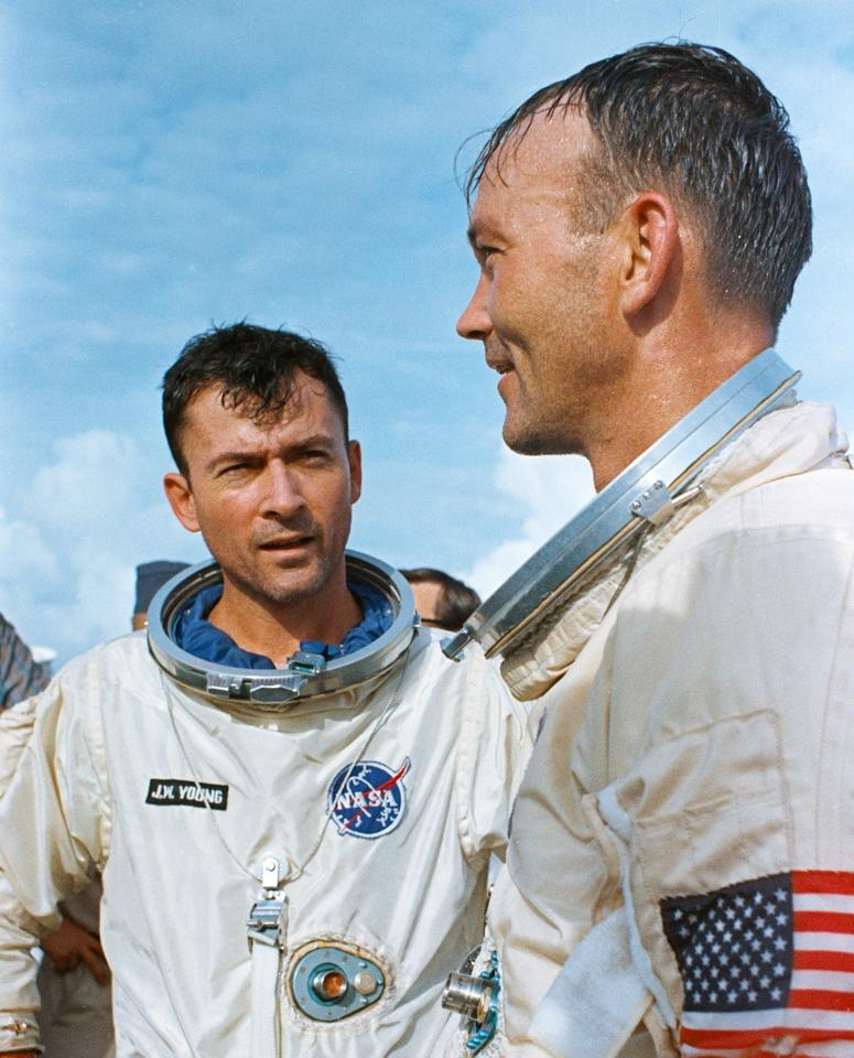 Gemini X astronauts John Young, left, and Mike Collins stand on the deck of USS Guadalcanal following splashdown and recovery on July 21, 1966.