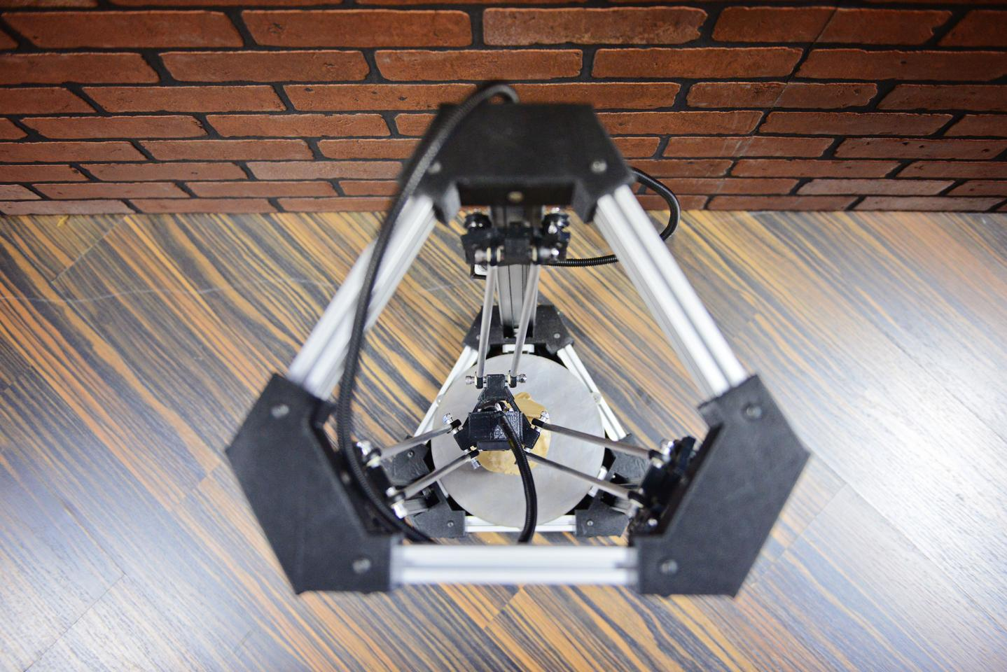 The DeltaMaker 3D printer features a striking symmetrical design