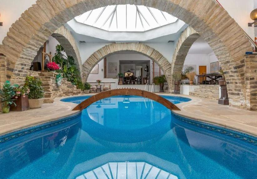 Underhill is arranged around a family recreation area with large stone arches and a heated indoor swimming pool