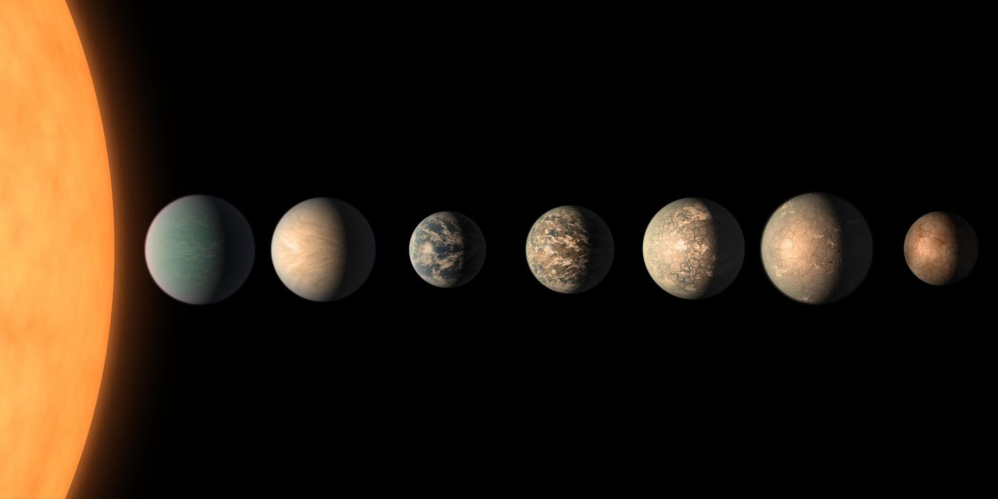 An artist's rendition of what the TRAPPIST-1 planets may look like, based on the most recent data on their size, density, composition, and orbital distance