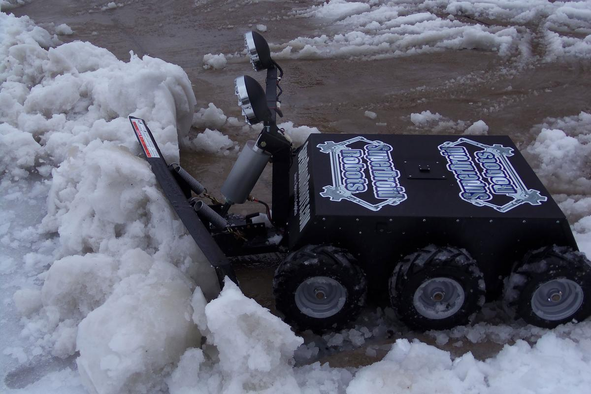 The SuperDroid snow plow in action
