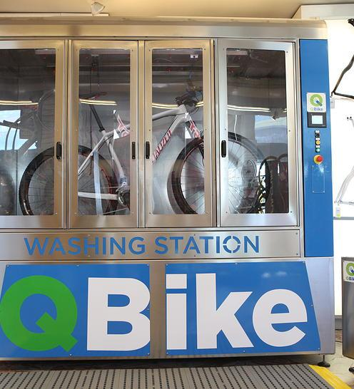 Users start by hanging their bike from its handlebar and saddle, on provided hooks and loops inside the washing station