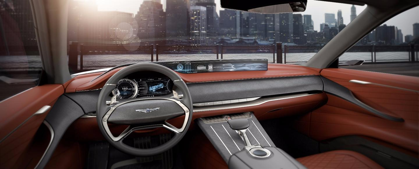 The stretched, wraparound dashboard defines the front cabin