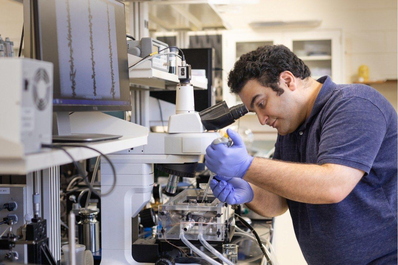 Doctoral student Farzad Ahmadi sets up a scale model of a passive anti-frosting surface