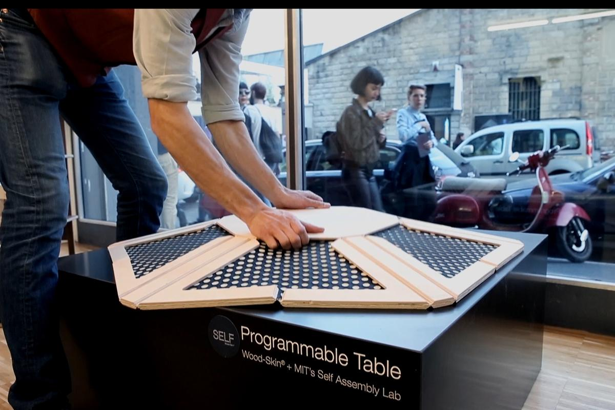 The Programmable Table pops into shape with a pull (Photo: Self-Assembly Lab, MIT + Wood-Skin S.r.I. + BIESSE)