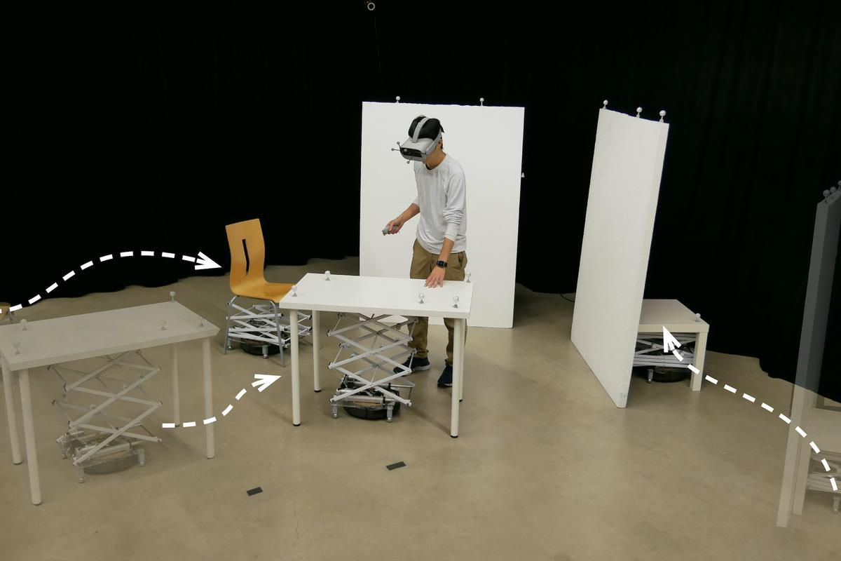 RoomShift is a VR system that uses robots to move furniture around a user to match the changing virtual environment