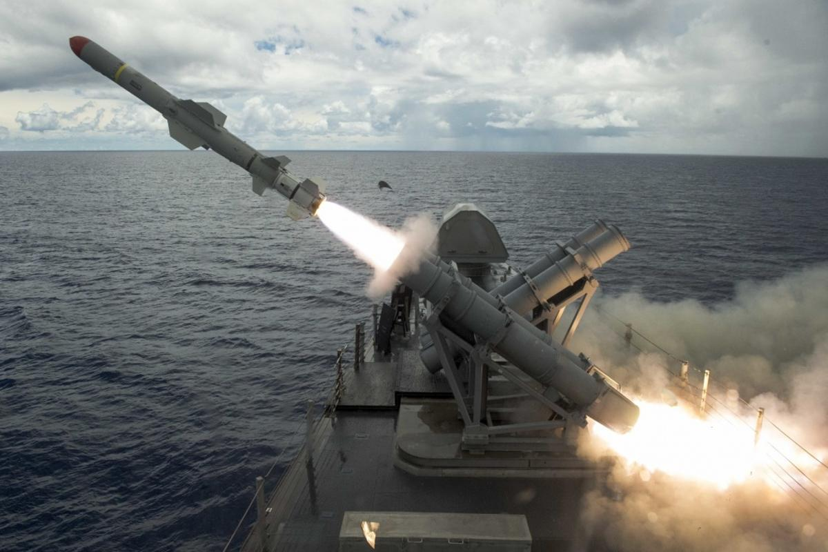 A harpoon missile launches from the missile deck of the littoral combat ship USS Coronado (LCS 4) off the coast of Guam