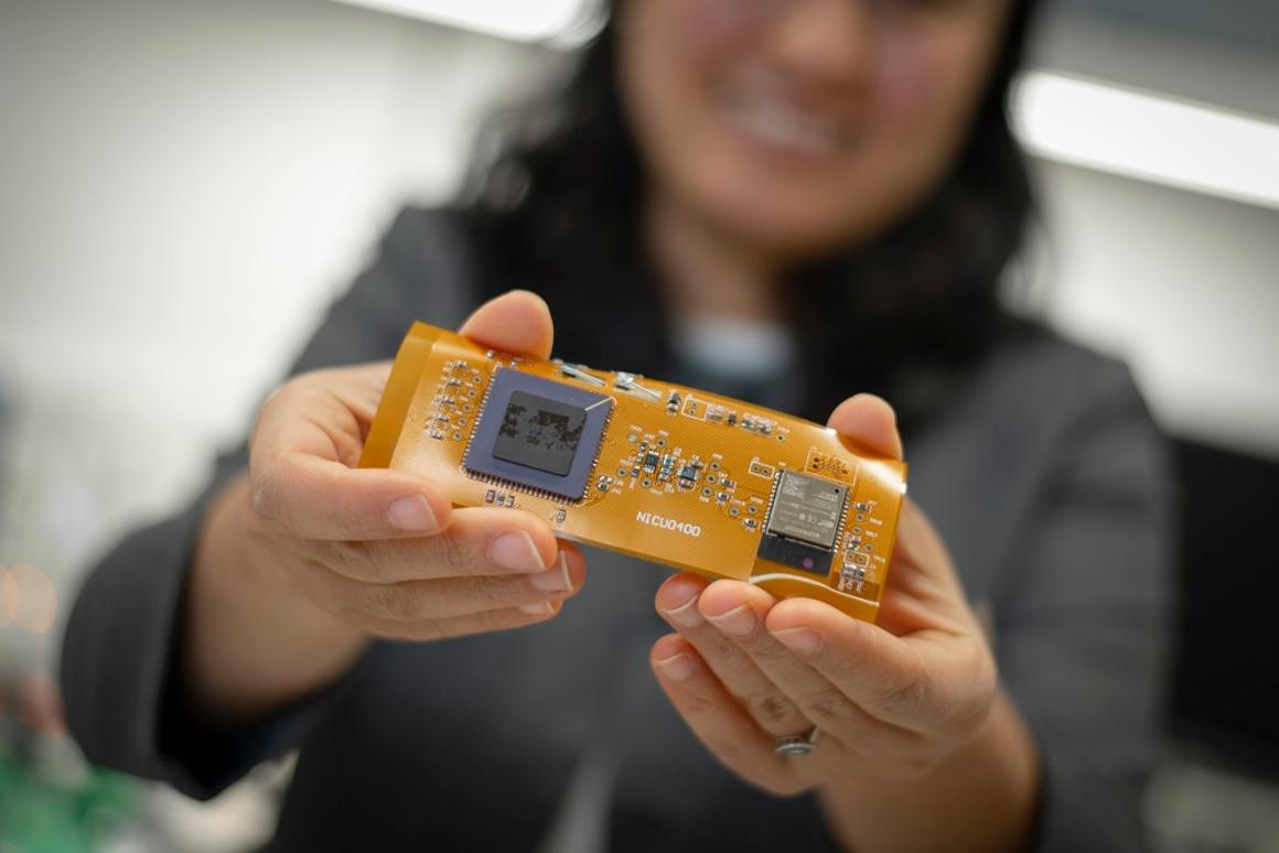 Ulkuhan Guler with the prototype optical sensor
