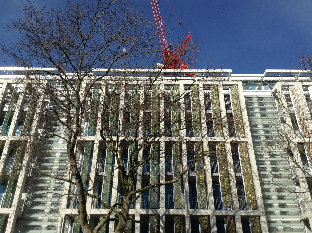 Kingsgate House under construction in Chelsea, London with gold solar shutters at the windows (Photo: Horden Cherry Lee Architects)
