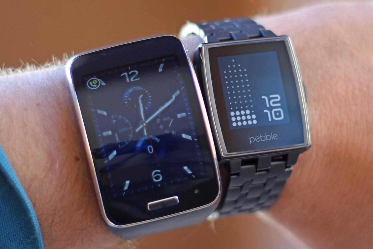 Gizmag takes a quick look at the radically different approaches we're seeing in the smartwatch space, with the Gear S (left) and Pebble Steel (Photo: Will Shanklin/Gizmag.com)