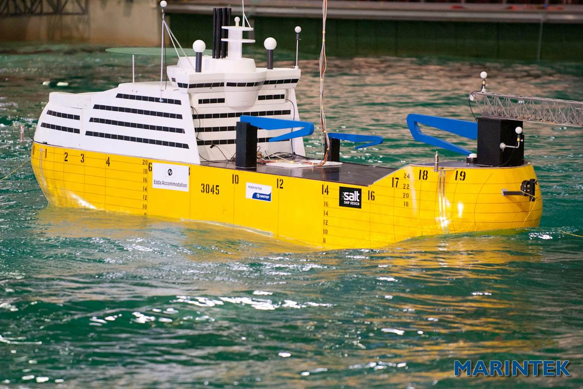 A model of the Offshore Accommodation Vessel, riding out the waves in a test tank (Photo: SINTEF)