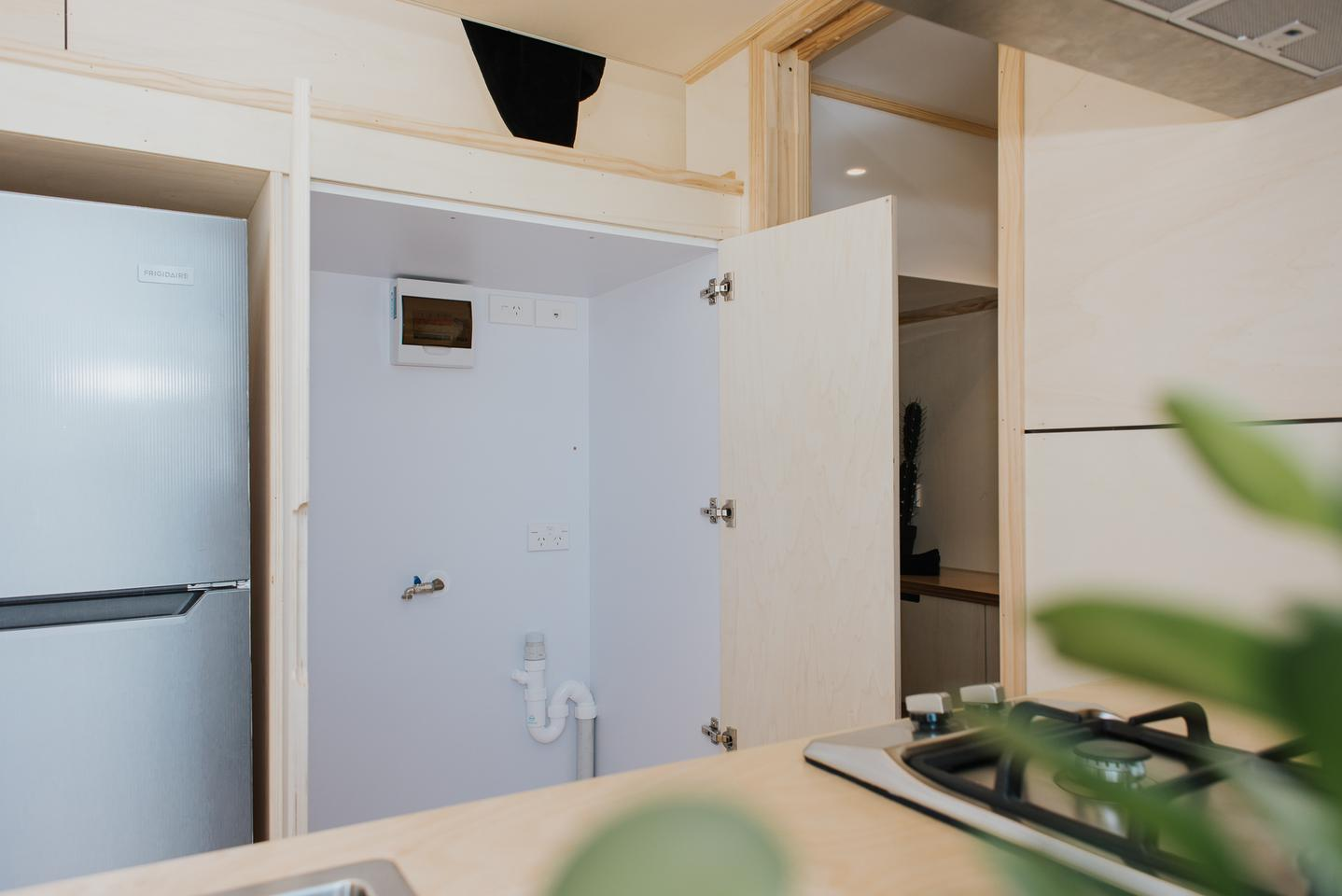 The Kapiti Tiny House's kitchen includes generous storage, for a compact tiny house