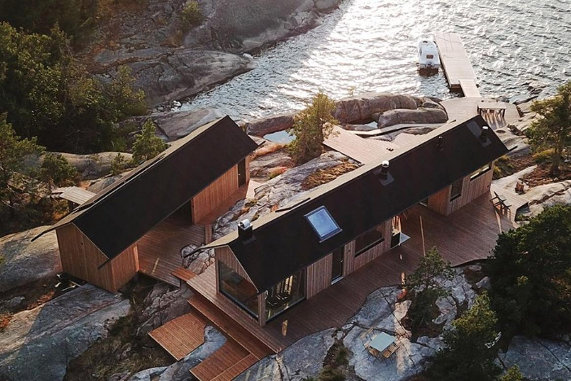 In order to work with the rocky conditions of the landscape and the strict building rules, the duo came up with an initial design for two self-sustaining timber dwellings