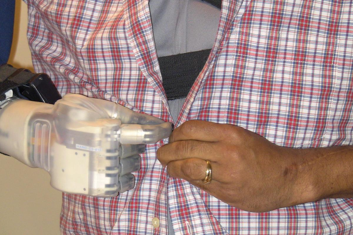 Buttoning a shirt is one of the 18 tasks assessed (Photo: Linda Resnik, U.S. Department of Veterans Affairs)