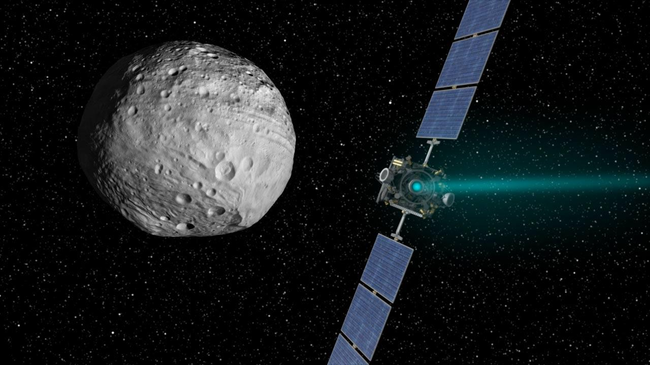 Artist's concept of Dawn approaching Vesta under ion drive (Image: NASA)