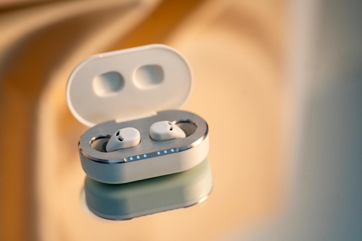Charge case holds the ear tips off the bottom of the case using magnets