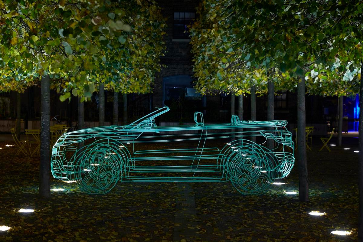 The unveiling was an event unto itself, preceded by lit wire frame ghosts of the vehicle