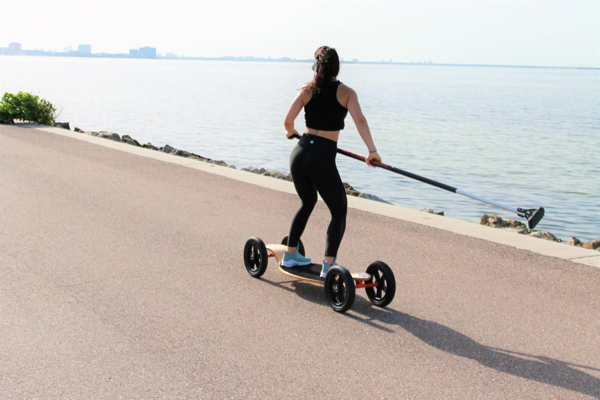 The SlingStick is used to propel the SlingBoard rider along