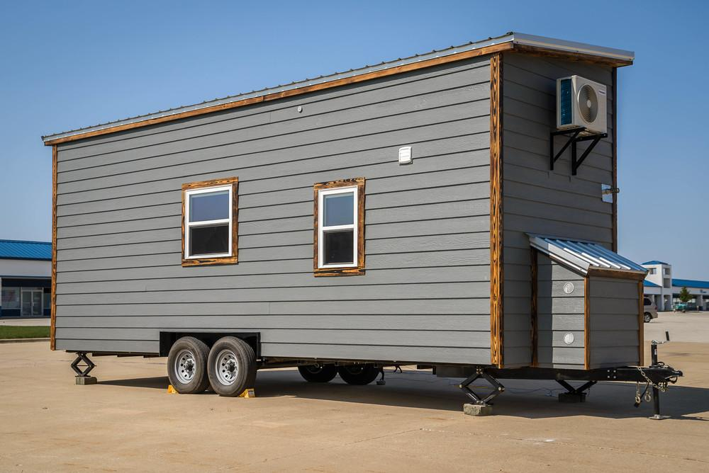 Measuring 8 x 24 ft (2.4 x 7.62 m), Triton sits on a double-axel trailer and features a similar color scheme to the the firm's Chimera tiny house
