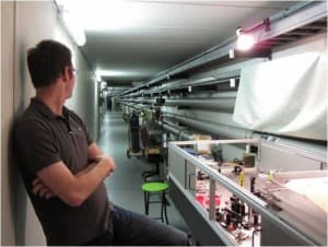 MIT physicist Sam Waldman in the laser lab where the holometer is being constructed