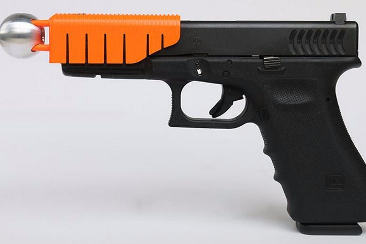 The Alternative hooks onto a standard semiautomatic pistol to reduce the velocity of a fired round