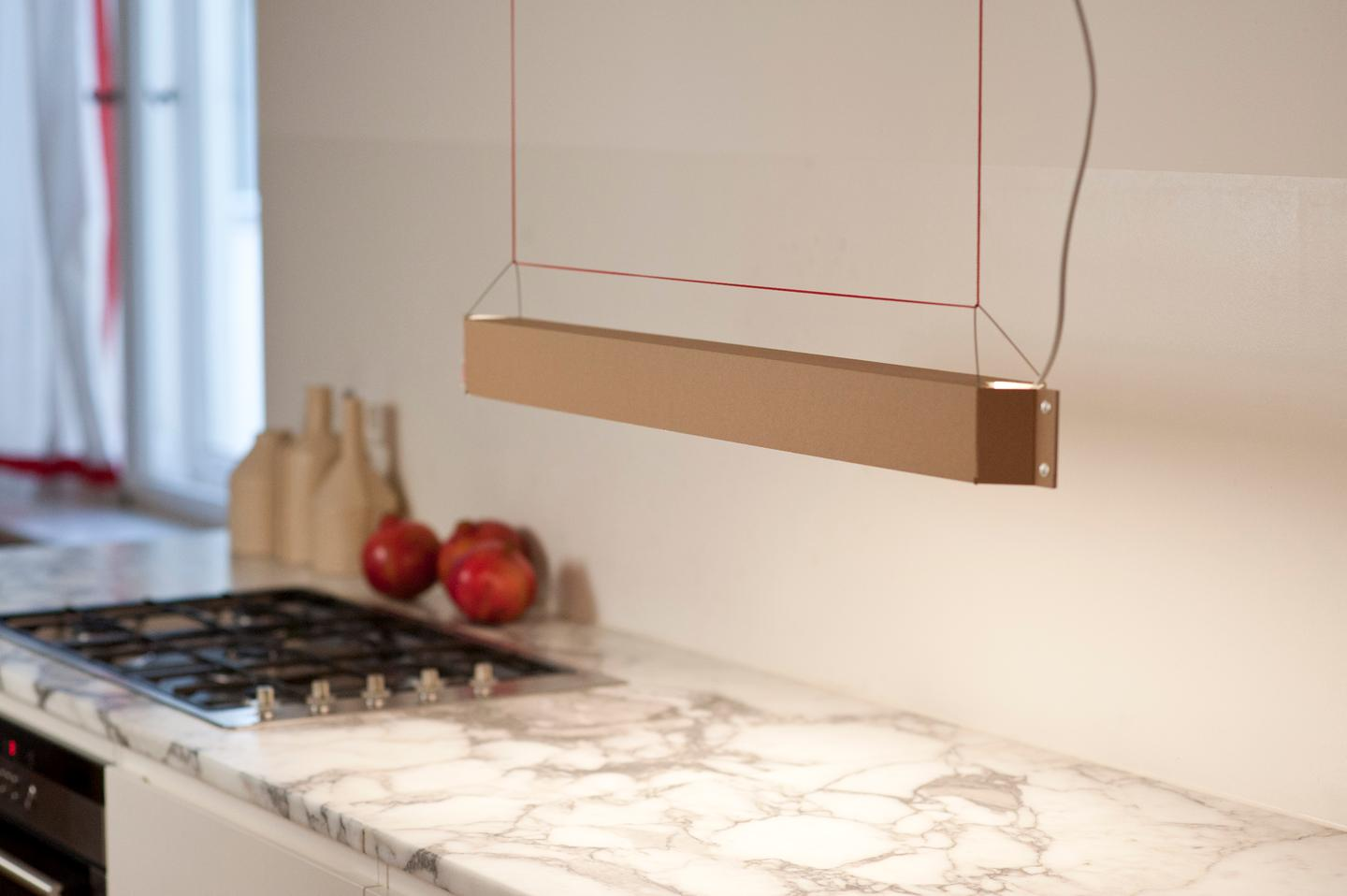 The lamp hangs from the ceiling and can be suitable for the kitchen, dining room, home workspace or office