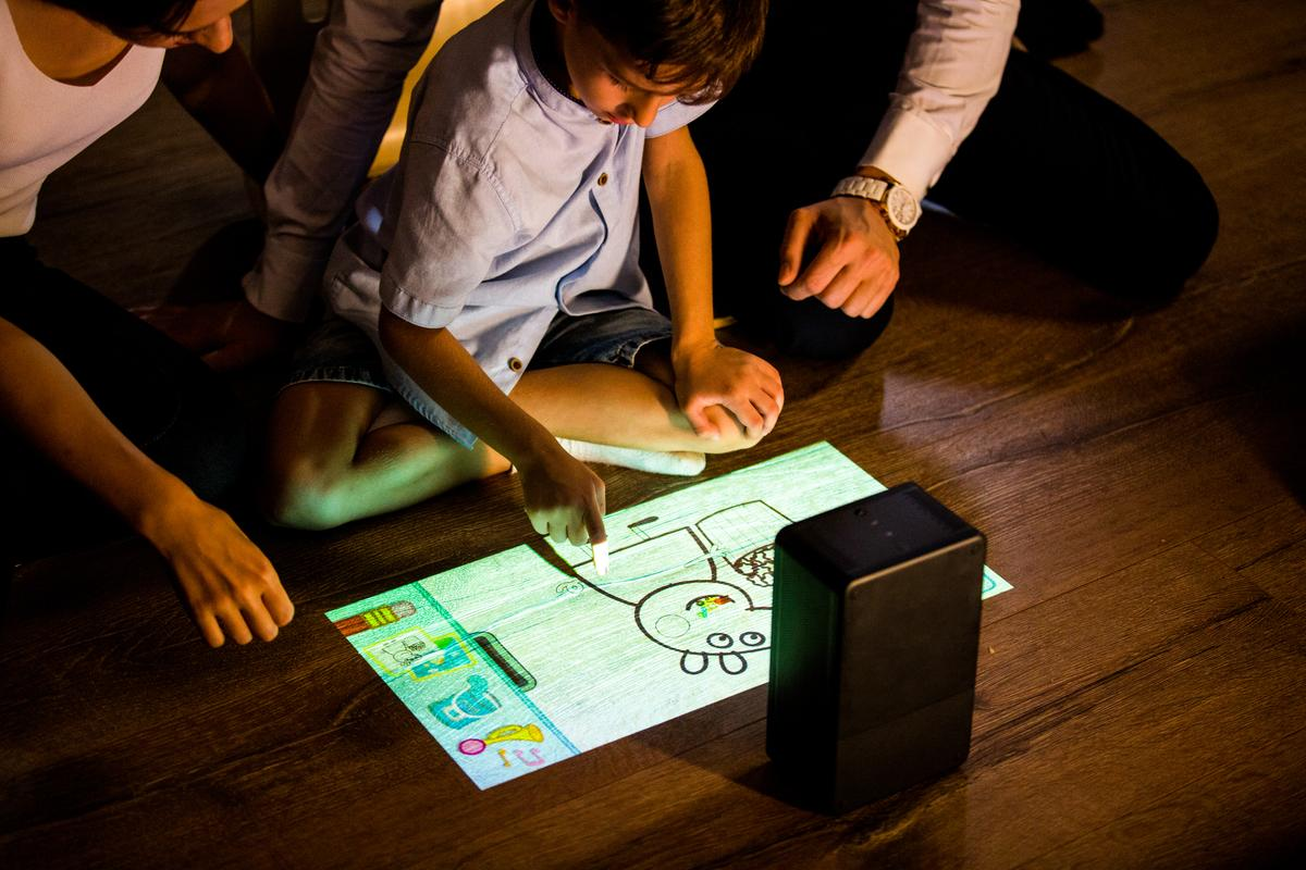 The puppy cube is able to track up to 10 simultaneous touch points on the projected image