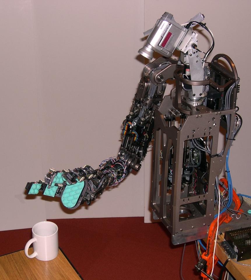 Torres-Jara's Obrero robot, seen here about to lift a ceramic mug