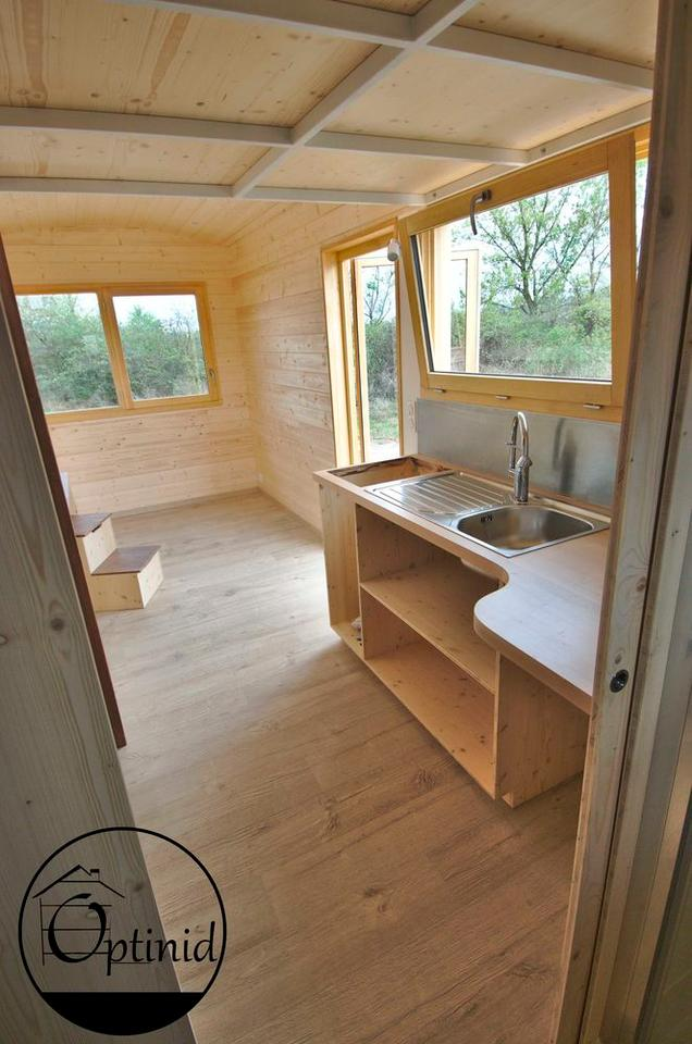 The Marie Ange's kitchen has a sink and cabinetry, as well as space for a fridge and oven