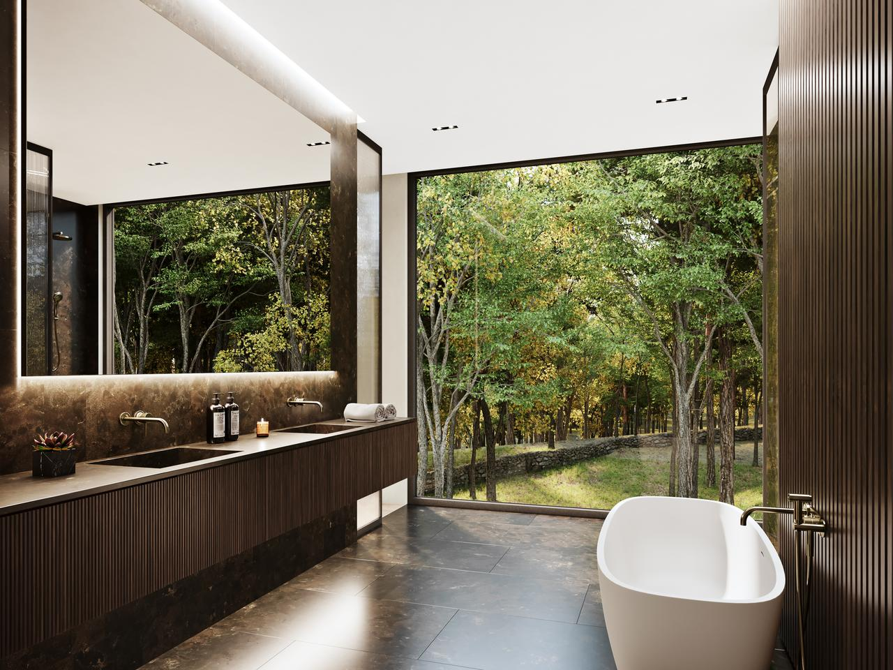 Sylvan Rock's master bathroom boasts twin sinks and superb views of the landscape outside