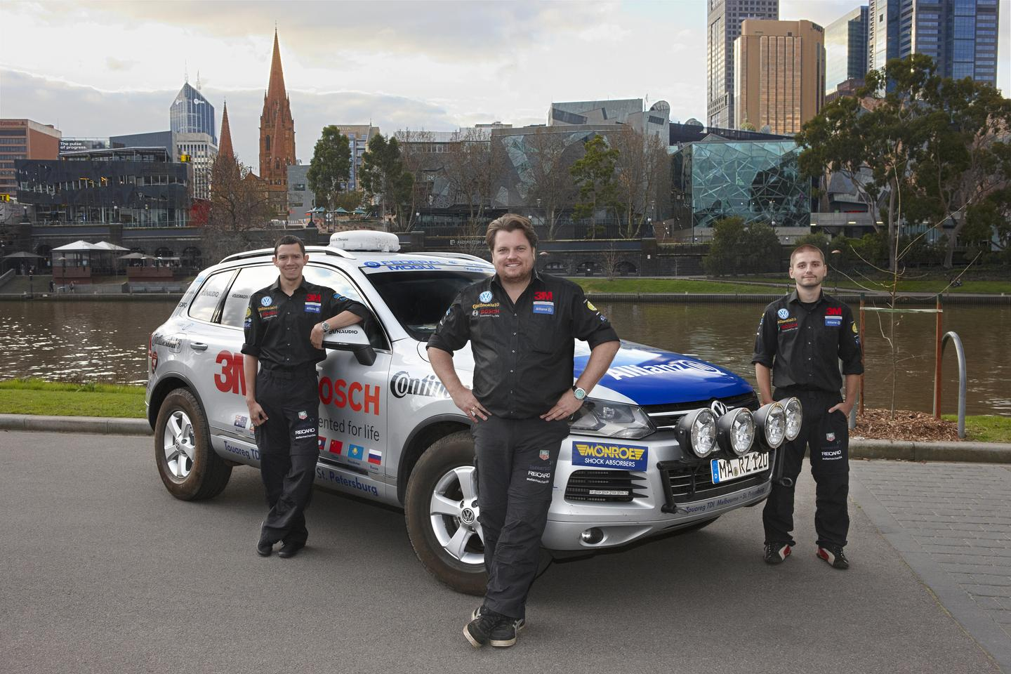 The Challenge4 team of Rainer Zietlow, Vlaimir Gagarin and Marius Biela on the banks of the Yarra River in Melbourne
