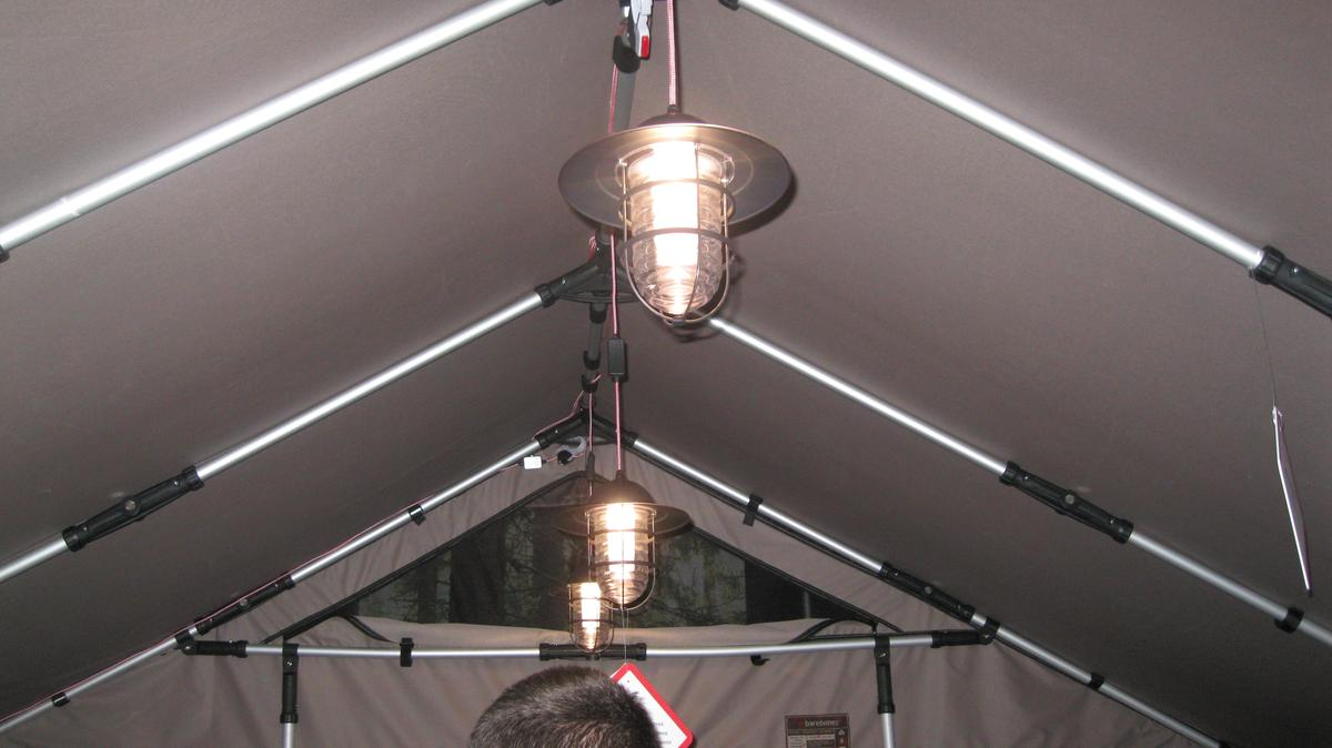 Lanterns hanging from the roof of the Barebones Safari Tent
