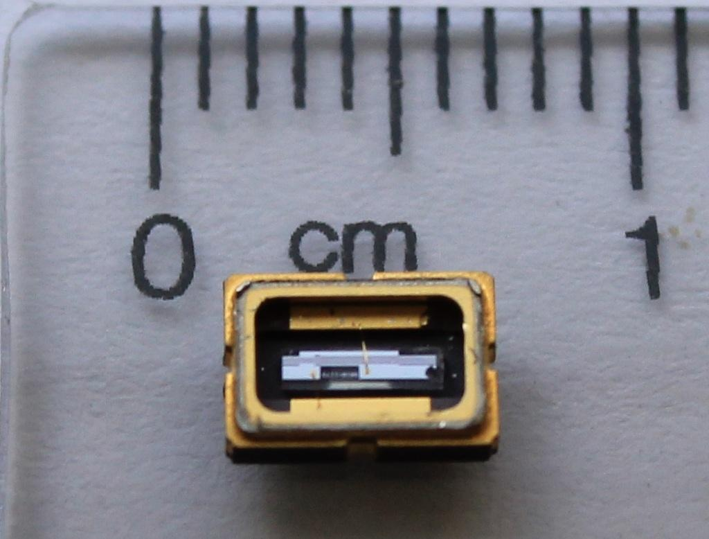 A droplet of blood is simply placed onto a microchip which is slotted into the device