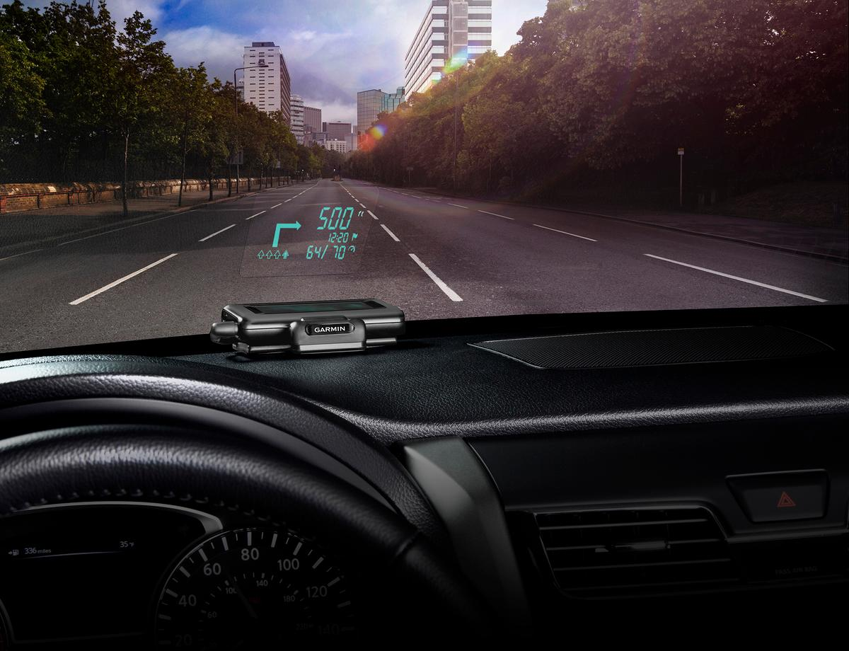 Garmin's portable HUD displays navigation information from a wirelessly linked smartphone on the inside of the windshield