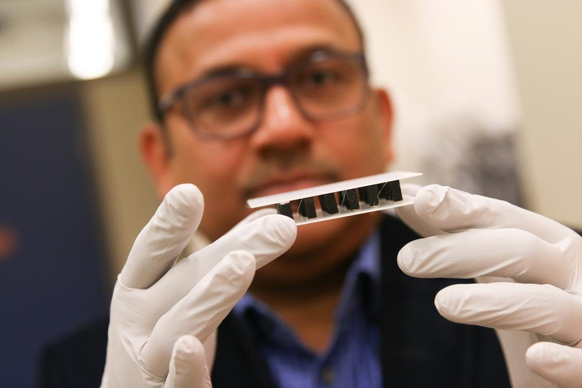 Ashutosh Tiwari holds up a sample of his team's thermoelectric material, which can generate electricity from a temperature difference without using toxic elements