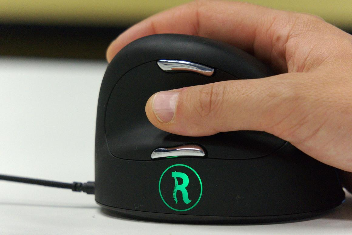 The thumb side of the mouse features an LED indicator that'll glow green, orange, or red to indicate whether you need a break