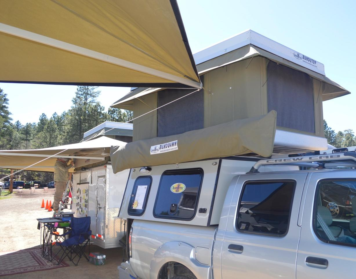 The model on show at Overland Expo includes a BunduTop electric-open tent and BunduAwn awning