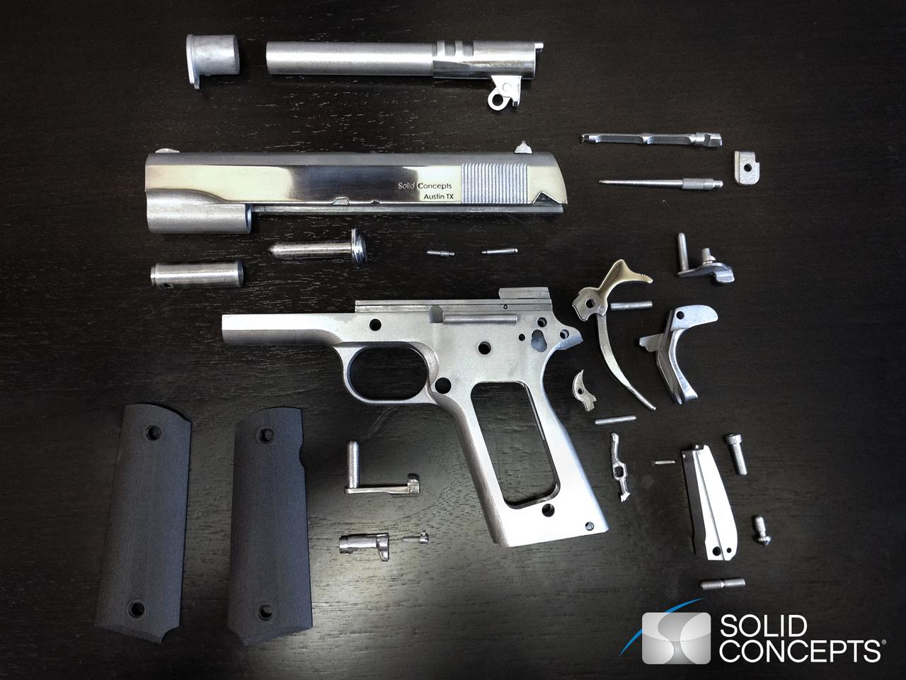 The disassembled Model 1911 45ACP showing its 3D-printed parts (Image: Solid Concepts)