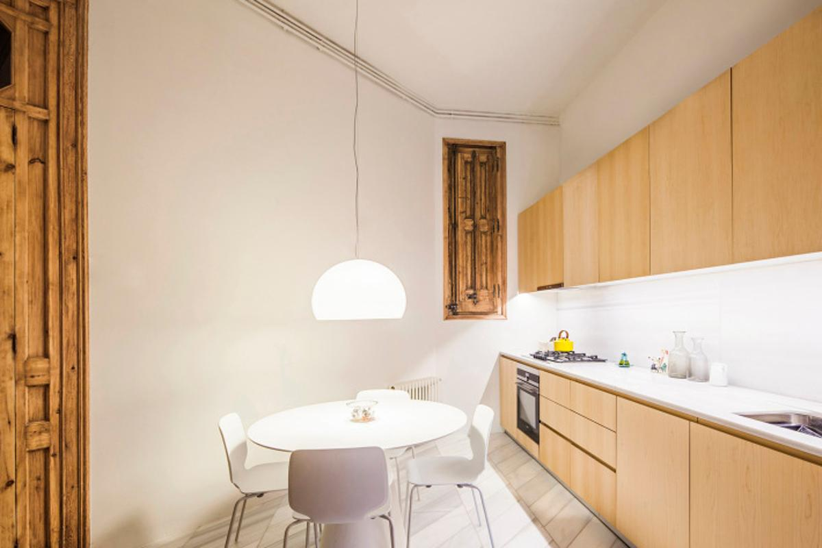 """The Cabinet Studio Apartment is filled with specifically designed and positioned elements such as contrasting 3D geometric and mosaic tile flooring; white walls anda small elevated """"door"""""""
