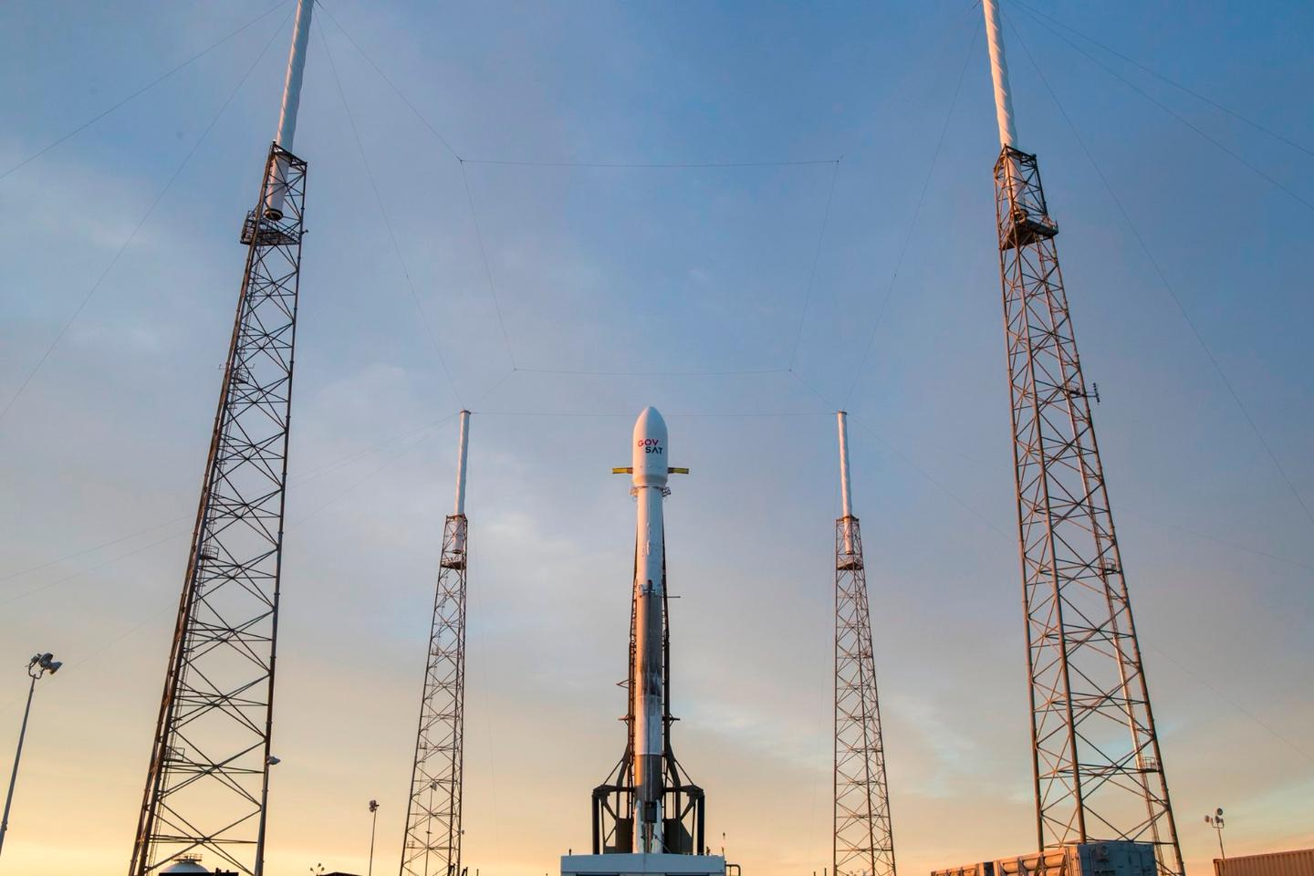 SpaceX's Falcon 9 rocket sits on the launchpad ahead of liftoff