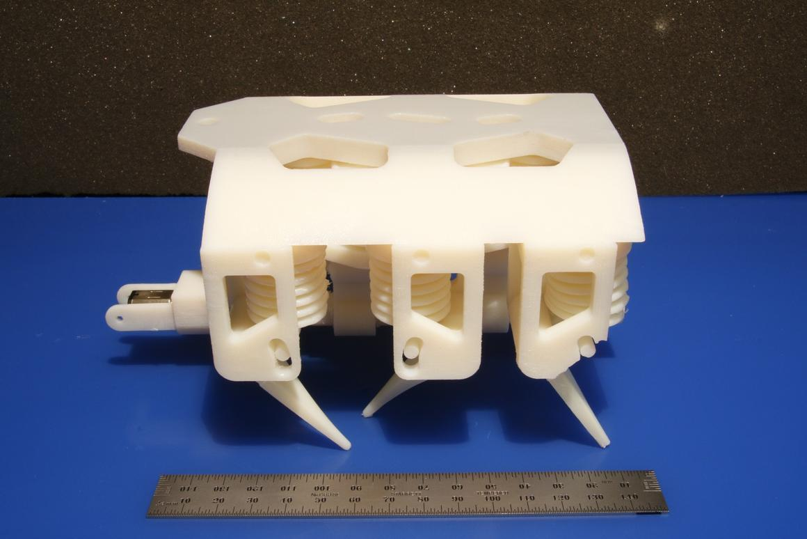 Hexapod robot with all mechanical parts fabricated in a singlestep