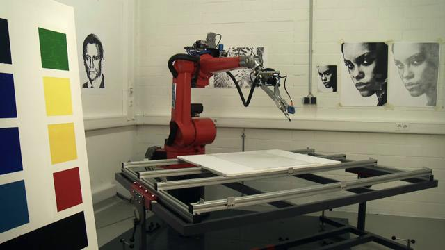 The eDavid system consists of a camera, a modified industrial welding robot arm, various paints and brushes, and computer software