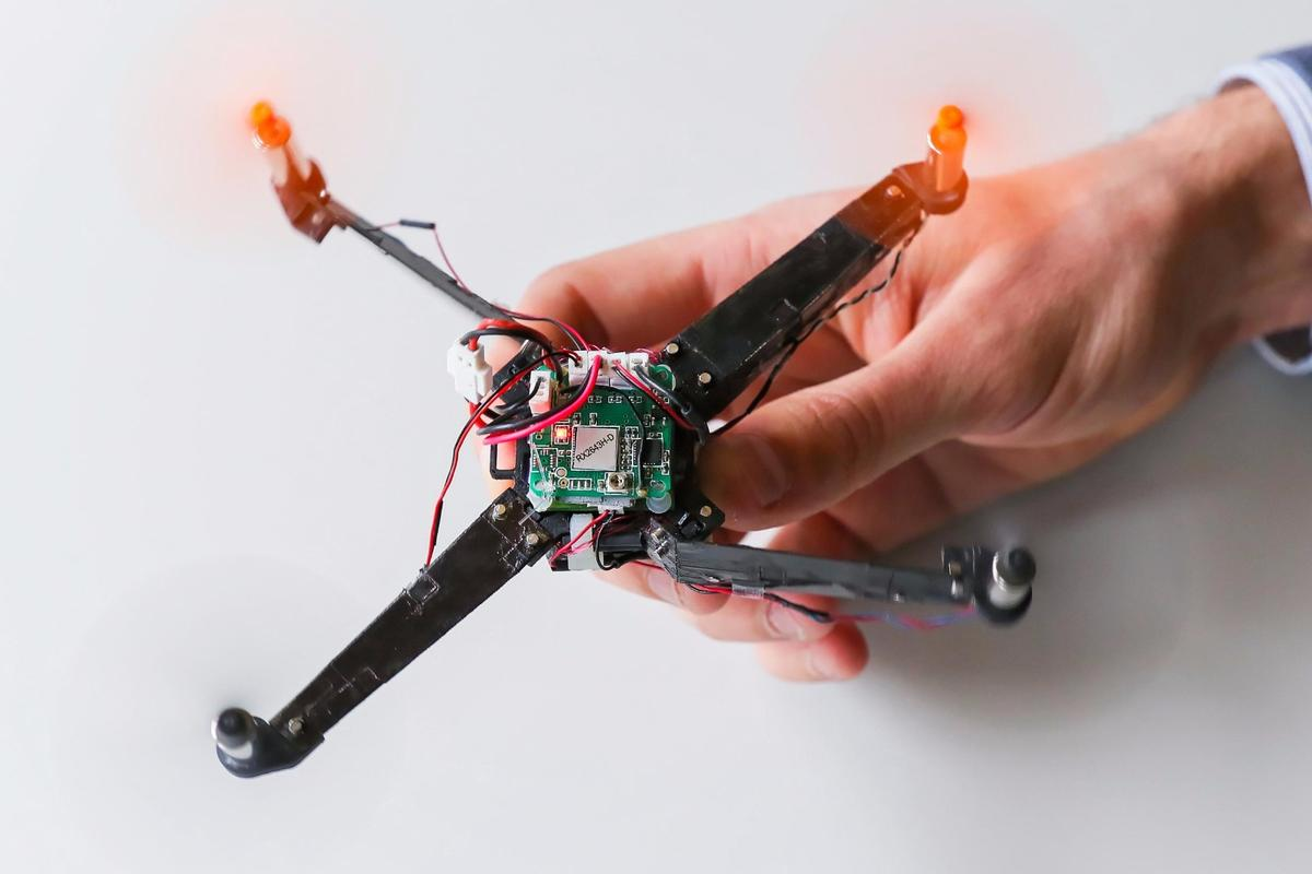 Once fired up, the power of the drone's rotors force the arms into position in one third of a second