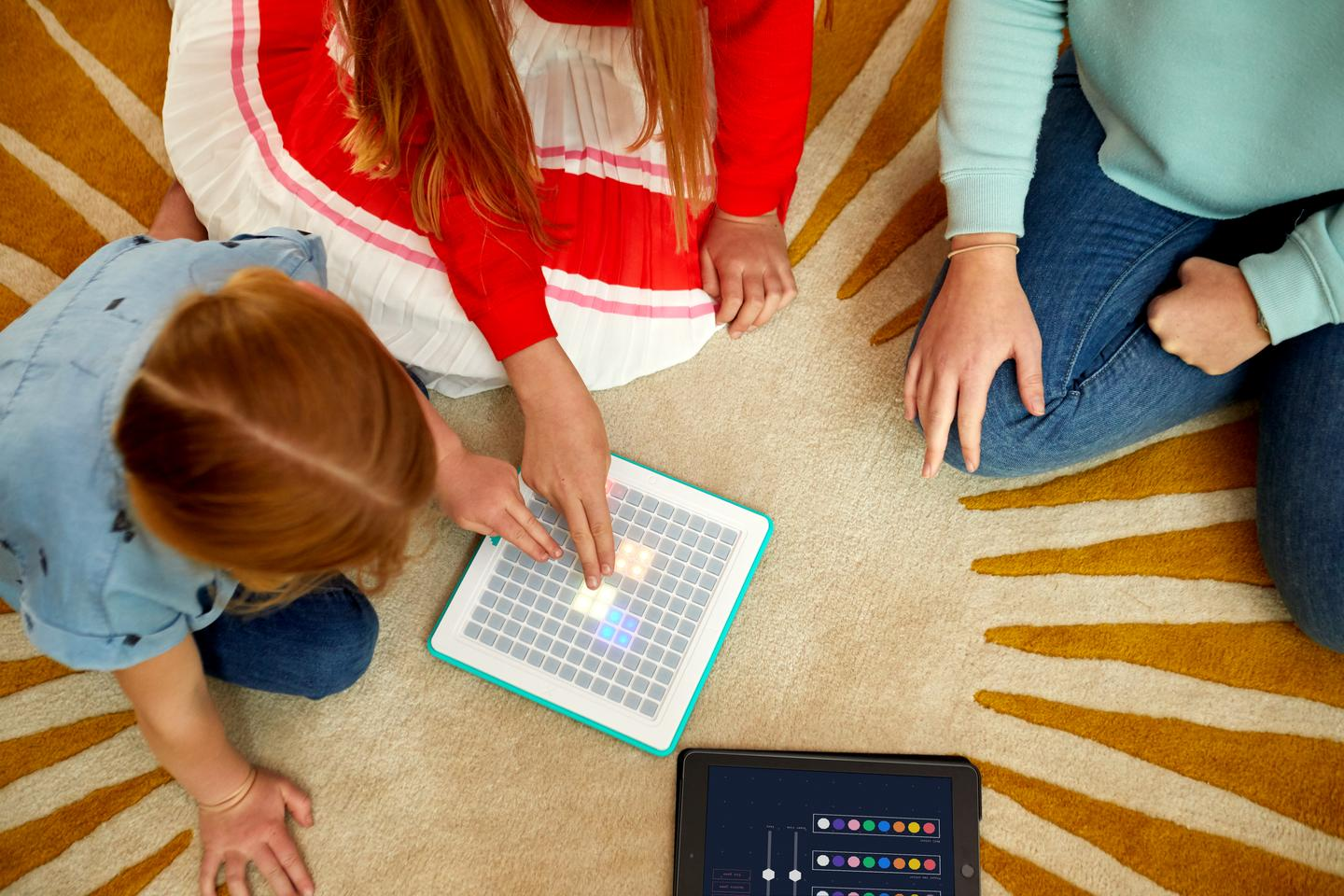 The Arcade Coder is made up of a tactile, programmable game console and an iOS app