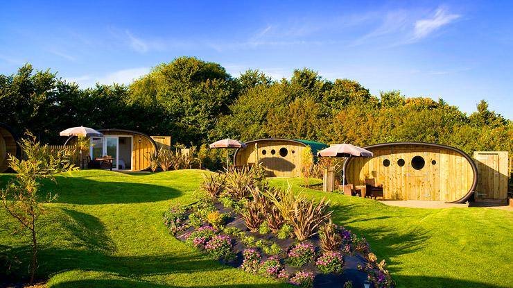 The eco-friendly accommodation includes a series of highly insulated eco pods, offering simple comforts surrounded by lush rolling hills