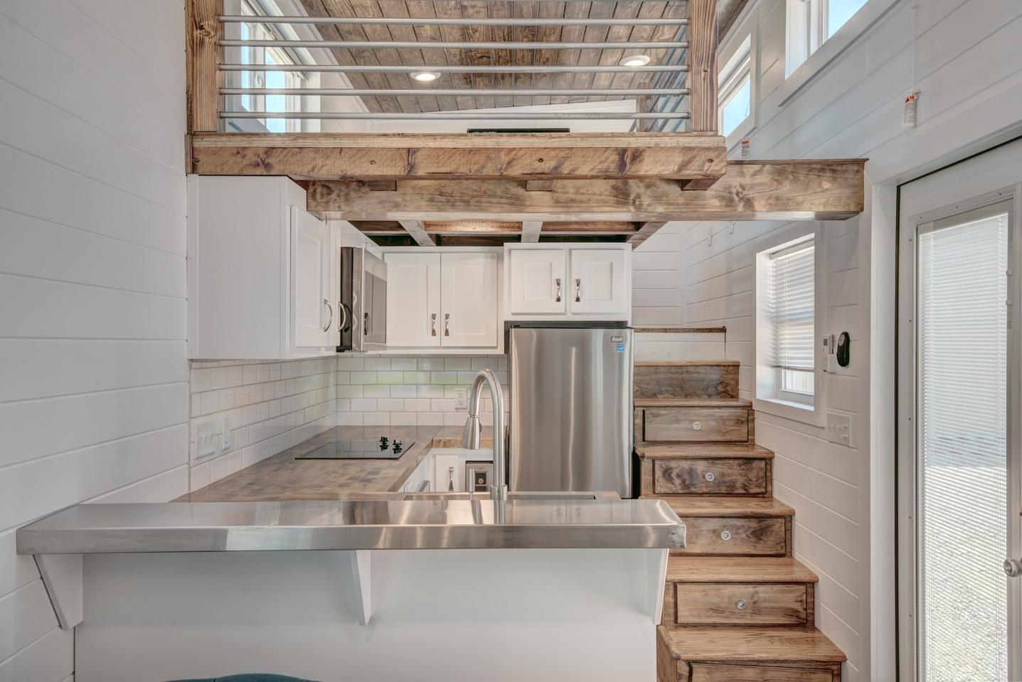 Luxurious tiny house squeezes in a loft with space to stand